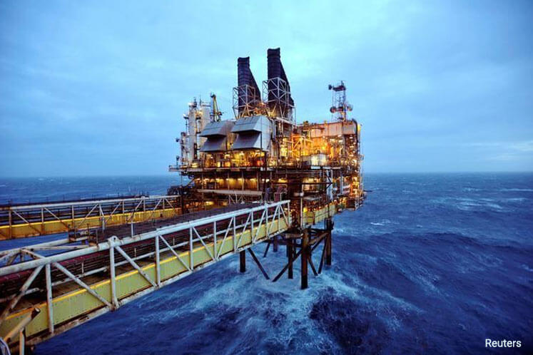 Oil rises in late trade, still down on the week as glut weighs