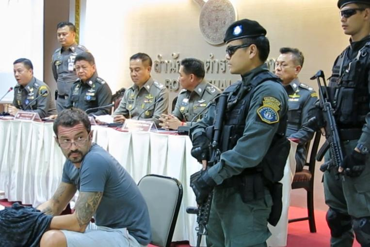 Xavier Andre Justo (seated) has accused The Edge Media Group of not paying him for information on the 1Malaysia Development Berhad-PetroSaudi International joint venture. – Royal Thai Police pic, July 24, 2015.