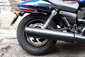 The rear of the bike has a single upturned exhaust pipe off the 749cc engine.