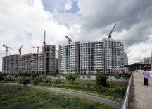 Singapore property developers walking a tightrope