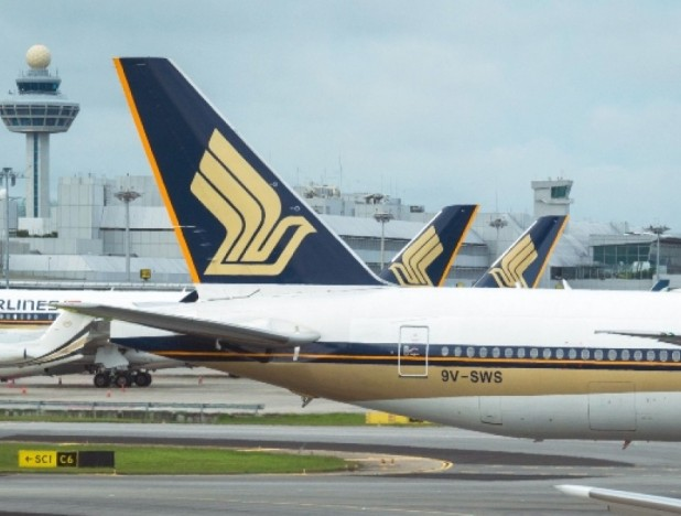 SIA says it looks forward to 'gradual recovery' in passenger operations amid re-opening of borders - THE EDGE SINGAPORE
