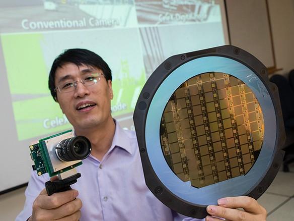 NTU's Assistant Professor Chen Shoushun shows his invention, Celex: an ultrafast, high-contrast camera
