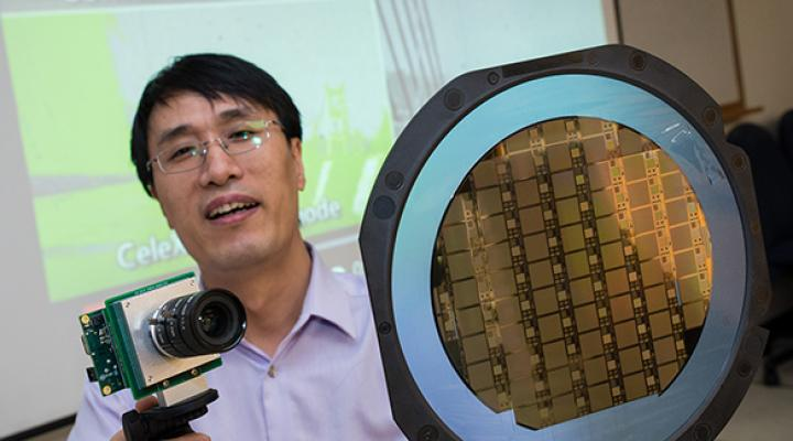 NTU's Assistant Professor Chen Shoushun shows his invention, Celex: an ultrafast, high-contrast camera